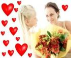 Girl with a bouquet of flowers for his mother and red hearts