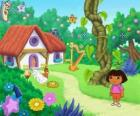 Dora, next to a house in the woods