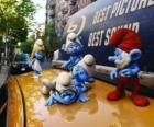 The Smurfs on the roof of a taxi
