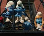 The Smurfs ready to jump from the balcony