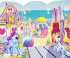 Several small ponies on the beach. Mein kleines Pony