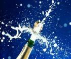 Uncorking a bottle of champagne to celebrate the new year
