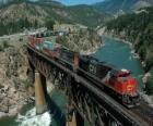 Train of goods passing over a bridge