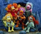 Several Muppets singing