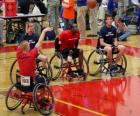 Wheelchair basketball player throwing the ball to the basket