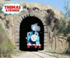 The friendly steam locomotive Thomas coming out of the tunnel