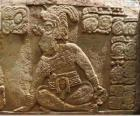 Mayan drawings carved on a stone