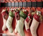 Stockings hung with Christmas gifts