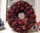 Christmas wreath with red fruits