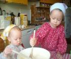 Children preparing a cake as a surprise gift for mom
