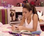 Violetta writing in his diary