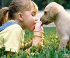 Girl and dog sharing an ice cream