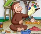 The curious monkey George makes puppets