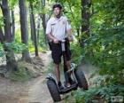 Segway, a two-wheeled, self-balancing, battery-powered electric vehicle