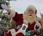 Santa Claus with a smile greets the children