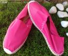 A pair of pink espadrilles