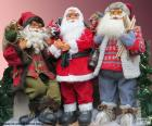 Three Santa Claus dolls