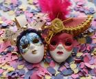 Two masks on the confetti-filled ground