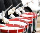 Several drums during a parade