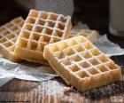 Waffles smothered with sugar icing, is served hot and them can add chocolate, jam, fruits etc...