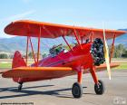 Red biplane aircraft