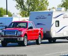 Red pickup truck with caravan