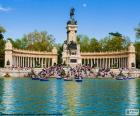 The pond of El Retiro Park and the monument to Alfonso XII, Madrid, Spain