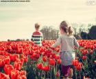 Girls between tulips