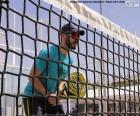 Paddle tennis player in the net