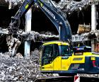 A excavator working on the demolition of a building