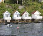 Four small houses built on the Lake in Norway