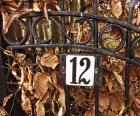 A number twelve in an iron door