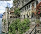 Hermitage of Santa Caterina del Sasso is a Roman Catholic monastery located in the municipality of Leggiuno, in the Province of Varese and the region of Lombardy, Italy. It is perched on a rocky ridge on the eastern shore of Lake Maggiore