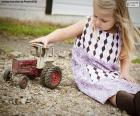 Girl playing with a tractor