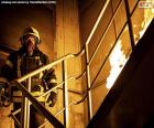 Firefighter on a burning ladder