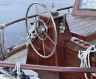 The wheel of the rudder of a sailboat
