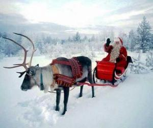 Santa Claus in its magical flying sleigh pulled by a Christmas reindeer puzzle