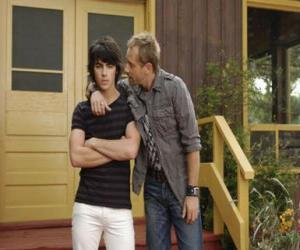 Shane (Joe Jonas) with his uncle Brown Cessario (Daniel Fathers) owner of camp Rock puzzle