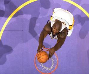 Shaquille O neal going for a slam dunk puzzle