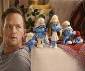 Some of the Smurfs by the man who helps them get back puzzle