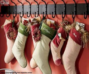 Stockings hung with Christmas gifts puzzle