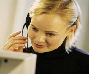Telemarketer working in the computer with headphones and microphone puzzle