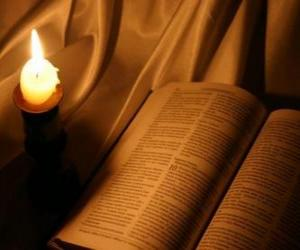 The Bible and a lit candle on the altar  puzzle