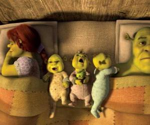 The family of Shrek, Fiona and three young ogres in bed. puzzle