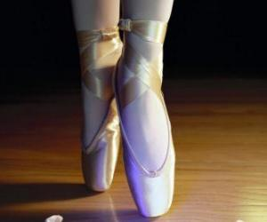 The feet of a dancer with the ballet shoes puzzle