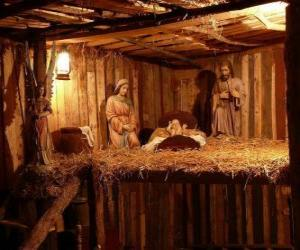 The Nativity scene figurines in a small wooden building puzzle