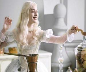The White Queen (Anne Hathaway) working on a potion puzzle