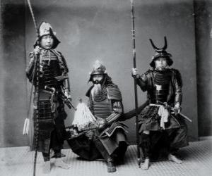 Three authentic samurai warriors, with the armor, the helmet kabuto and armed puzzle