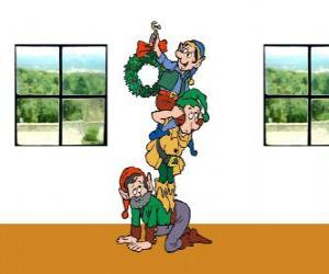 Three elves of Santa Claus hanging a Christmas wreath puzzle