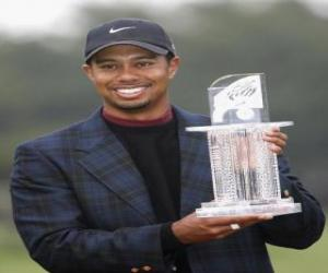 Tiger Woods with a trophy puzzle